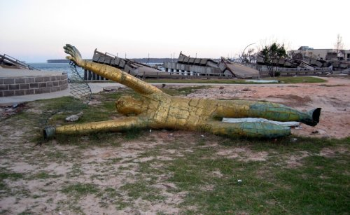 Golden Fisherman statue knocked off pedestal onto ground